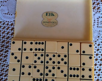A Set Of Dominoes In The Original Box (Broken Lid) With A Sticker That Reads Elk Brand Dominoes The Elkloid Co. Providence R.I.