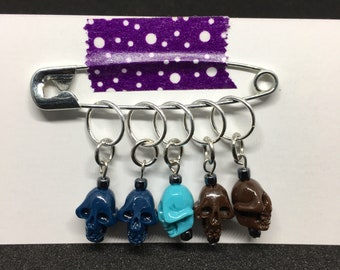 Blue and brown skull stitch markers
