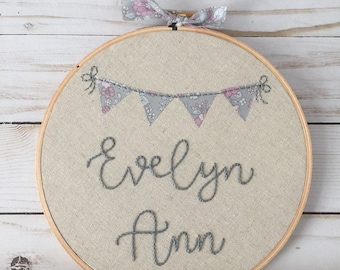 personalized name . hand embroidered hoop art . made to order . custom . baby gift . nursery decor . pink and gray . flower buntings . linen