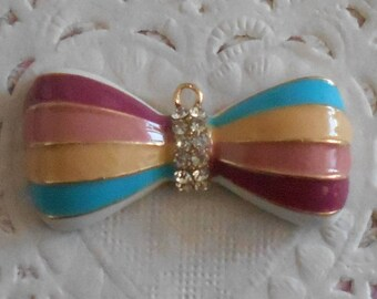 Bow charm goldtone painted different colors and rhinestones 3,50 cm width