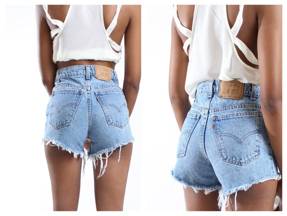 Vintage Levis high waisted denim shorts uniquely styled for you by Bailey Ray and Co. Every single pair is made by hand making your pair one on of a kind. All of our Levi shorts sport that signature V pocket stitching dating back to In case youre counting, thats nearly years.