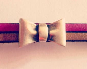 Leather strap and a pretty bow