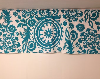 Turquoise blue and white suzani lined valance, 52W x 18H