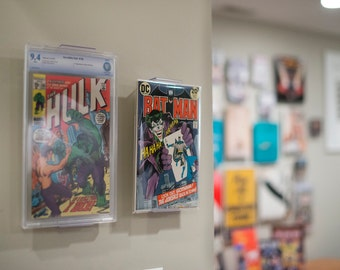 ComicMount Comic Book Display - Adjustable Wall Mount or Shelf Stand.  New Patented display product developed by CollectorMount™