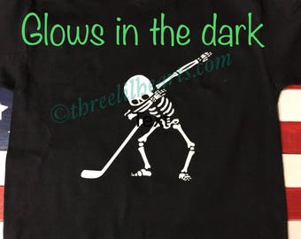 Sports hockey, soccer, baseball, football... you name it dabbing glow in the dark skeleton perfect for Halloween t shirt