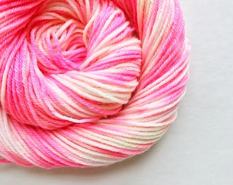 POP CREAM hand dyed yarn speckle. choose your base from fingering, sock, dk, or bulky yarn. merino wool. hot pink and white speckle yarn
