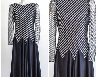 1970s long sleeve black and silver drop waisted dress