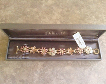 A Pretty Pink, White and Gold Tone Bracelet with    Daisy's Dillard's.