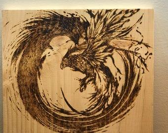 wood burning phoenix in zen circle phrography