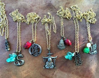 Coro jewelry, Coro necklace. Upcycled charm necklaces. Gold charm necklace. Buddhism jewelry. Chinese, Japanese, Asian charms.