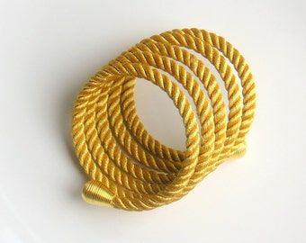 Rope  bracelet gold with memory wire