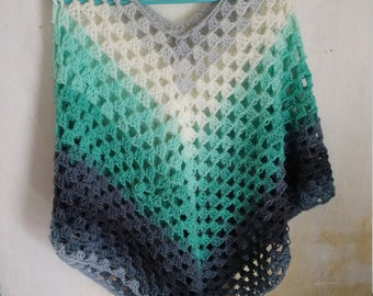 Woman's Aqua, white, grey, and black spring poncho.