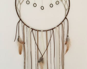 Large Dreamcatcher in the Colours Brown, Beige & Cream with a Multiple Hanging Pendant Detail and Feathers.