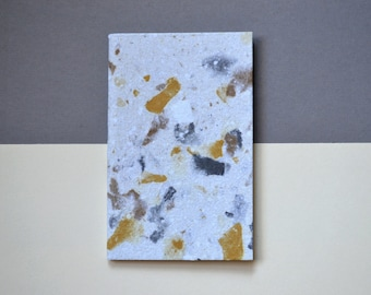 Cream, yellow and gray speckled handmade paper book