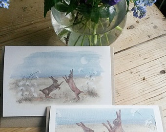 Boxing hares. Hand painted Norfolk Hares fighting. Printed on 100% recycled card. Hares at moonlight. Wildlife card. Hare card.