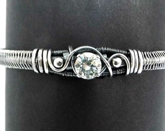 Fine and Sterling Silver Bracelet with a Moissanite Focal