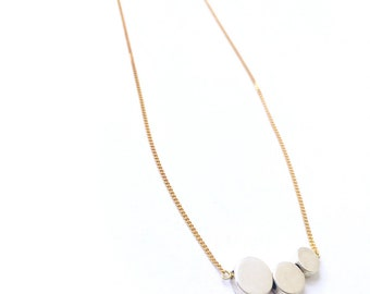 Sterling silver necklace with chain and three silver discs that can be personalized with initials or numbers
