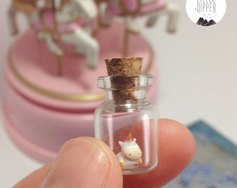 Micro unicorn in a tiny bottle