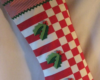 Handmade red and white striped Christmas stocking.