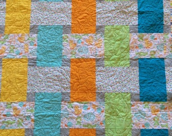 Multi-colored  baby quilt with cute animals
