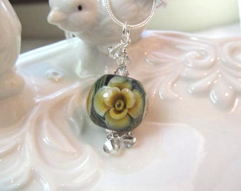 Necklace green & tan floating flower glass lampwork bead with crystals