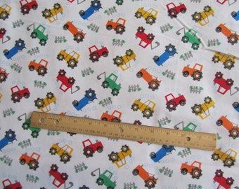 White with Multicolored Tractors Flannel Fabric by the Yard