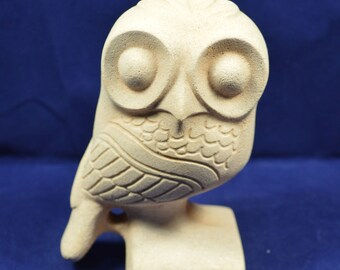 Owl wide eyes sculpture statue