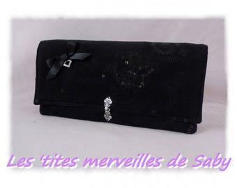 embroidered black evening bag has sequins