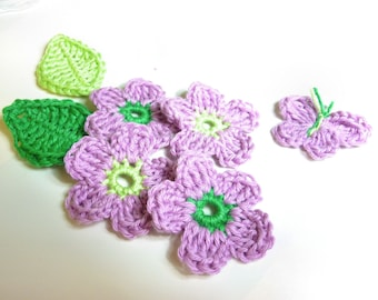 set flowers, leaves and purple and green crochet bow