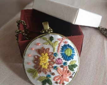 Floral hand embroidered pendant