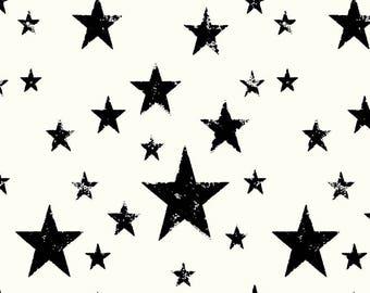 AVALANA Tissu jersey coton AVALANA Etoiles noires surfond blanc x40cm