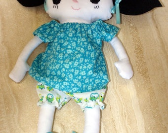 Black haired stuffed doll