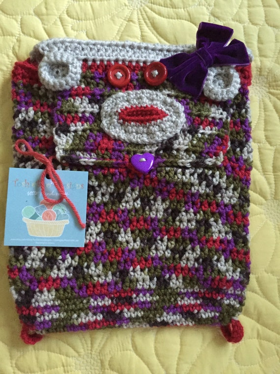Sock Monkey Backpack Crocheted in a striping yarn with purple, red, green, brown, and linen