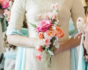 Coral and pink spring artificial wedding bouquet with cherry blossoms, roses, peony, ferns, lilies of the valley