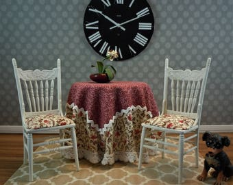 Dollhouse Miniature furniture in twelfth scale or 1:12 scale.  Skirted table with 2 chairs.  Item #335.