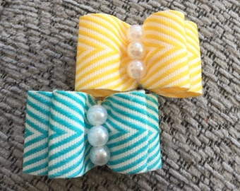 Yellow or blue patterned dog bow