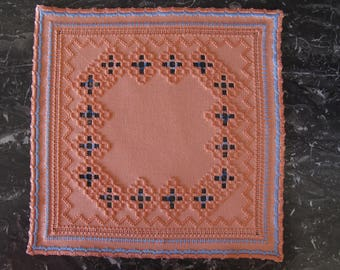 Orange and blue Hardanger embroidered doily