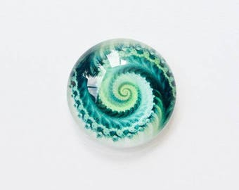Featuring 20mm green swirl glass cabochon