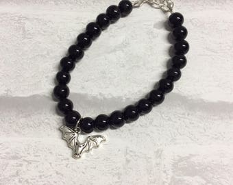 Black faux pearl bead bracelet with bat charm