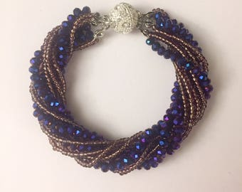 Blue and gold multi strand statement beaded beacelet with magnetic clasp