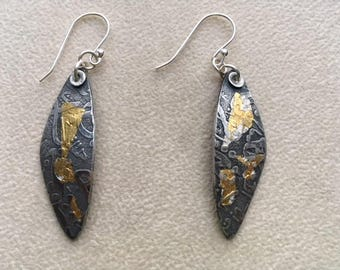 Sterling and 24k gold dangle earrings.