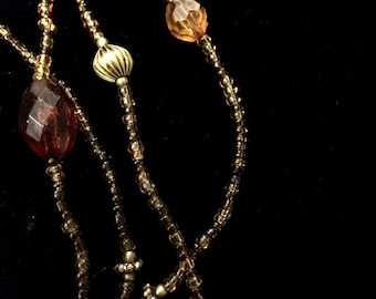 Delicate amber-coloured bead necklace