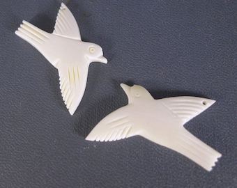 A Pair of Carved Bone Bird Focal Beads, Swallow