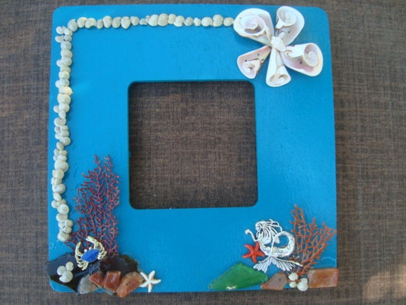 Seaside mermaid frame made out of wood, painted teal and decorated w ...