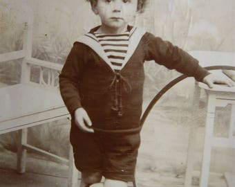 Kid in nautical outfit with a hoop photography little sailor boy sepia studio portrait antique french photo  souvenir memorabilia children