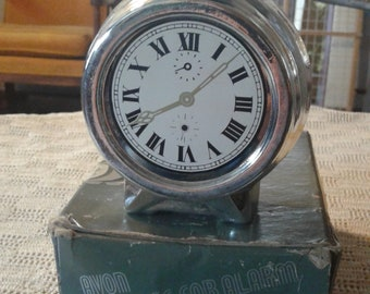 Avon's Silver clock decanter.