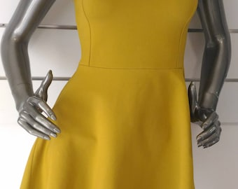 The dress (flared with studs and rhinestones decoration) yellow