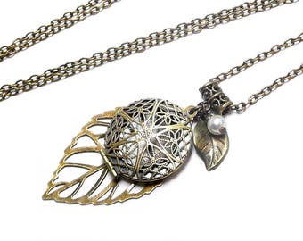 Worn necklace photo Locket pendant leaf with vintage bronze Ivory Pearl