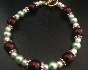 Brown, White, and Green Glass Pearl Bracelet With Gold Clasp