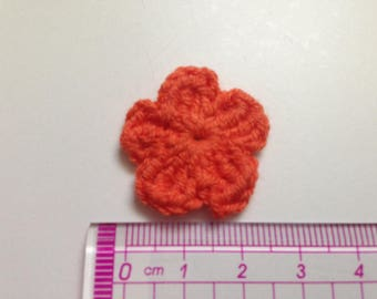 orange cotton and crochet flower